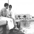 Elizabeth Taylor sittingwith her husband Eddie Fisher. - 8x10 photo