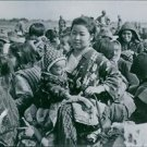 Civilians return from hiding places in hills of Okinawa.The Battle of Okinawa,