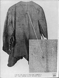 Coat of President John F. Kennedy, showing bullet entrance hole.  - 8x10 photo