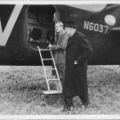 Winston Churchill walking with Mr. Harry Hopkins. - 8x10 photo