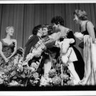Judy Garland congratulated after show by woman with flowers. - 8x10 photo