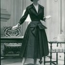 A woman posing for the camera wearing a dress and a hat.- 1955 - 8x10 photo