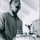 Muhammad Ali(Cassius Clay)celebrating his 22nd birthday with a huge cake. - 8x10