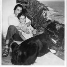 Anna Magnani sitting with a small child. - 8x10 photo