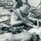 Robert Mitchum giving massage to woman. - 8x10 photo