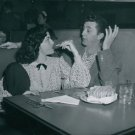 Robert Mitchum talks to a lady. - 8x10 photo