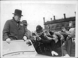 Winston Churchill in a car. - 8x10 photo