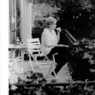 Kim Novak having a cup of coffie. - 8x10 photo
