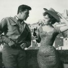 Gina Lollobrigida holding a gun with man. - 8x10 photo