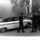 Robert F. Kennedy standing by car with people.  - 8x10 photo