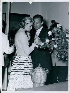 Grace Kelly and Oleg Cassini. - 8x10 photo