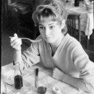Brigitte Bardot holding fork. - 8x10 photo