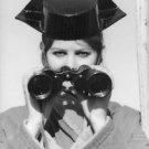 Claudia Cardinale holding telescope. - 8x10 photo