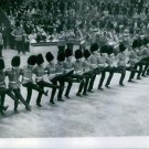 People performing during an event. - 8x10 photo