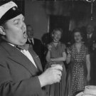 Jussi Björling singing with people. - 8x10 photo