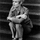 Brigitte Bardot sitting on stairs.  - 8x10 photo