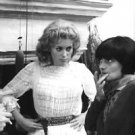 Catherine Deneuve looking at woman.  - 8x10 photo