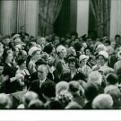 Jacqueline Kennedy surrounding by people. - 8x10 photo