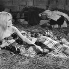 Brigitte Bardot lying down. - 8x10 photo