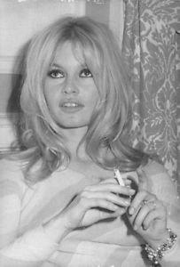 Brigitte Bardot during smoking. - 8x10 photo