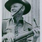 Portrait of Bert Oldfield in an army uniform holding gun in 1941. - 8x10 photo