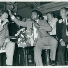 Muhammad Ali(C) holding mike at an event with Thomas Hellberg(L) and Jim Downer(