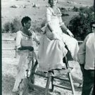 Brigitte Bardot sitting on leader. - 8x10 photo
