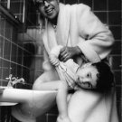 Josephine Baker cleaning baby's back. - 8x10 photo
