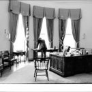 John F. Kennedy working in the oval office. - 8x10 photo