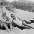 Georges Jean Raymond Pompidou lying with a woman on beach. - 8x10 photo