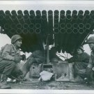 Soldiers under rocket tubes. - 8x10 photo