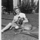 Lauren Bacall pampering dog.  - 8x10 photo