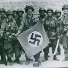 U.S. soldiers holding a German flag. 1944. - 8x10 photo