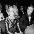 Françoise Dorléac sitting with man. - 8x10 photo