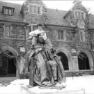 Évariste sitting on statue and playing guitar, Princeton University.  - 8x10 pho