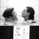 Audrey Hepburn with Albert Finney, swimming. - 8x10 photo