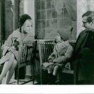 Brigitte Bardot talking to a child. - 8x10 photo