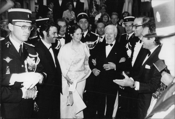 Charlie Chaplin with his wife Oona. - 8x10 photo