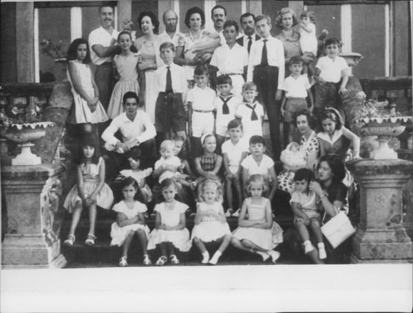 Queen Fabiola holding child with people. - 8x10 photo