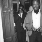 Ray Charles Robinson walking out of door. - 8x10 photo