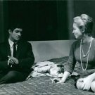 Sami Frey sitting on bed with woman.  - 8x10 photo