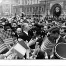 John F. Kennedy surrounding by people. - 8x10 photo
