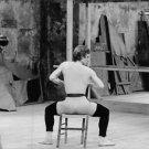 Rudolf Khametovich Nureyev sitting on chair. - 8x10 photo