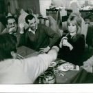 Brigitte Bardot playing cards with friends.  - 8x10 photo