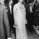 Claudia Cardinale standing and looking away. - 8x10 photo