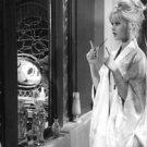 Brigitte Bardot looking herself in mirror.  - 8x10 photo
