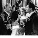 Brigitte Bardot relishing drink with friends.  - 8x10 photo