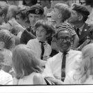 John F. Kennedy, Jr. surrounding by people. - 8x10 photo