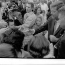 John F. Kennedy shaking hand with fans.  - 8x10 photo