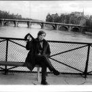 Rudolf Khametovich Nureyev sitting on bench - 8x10 photo